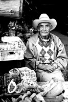 Local man sells his wares of spices and incenses. Chichicastenango, Guatemala, 2010