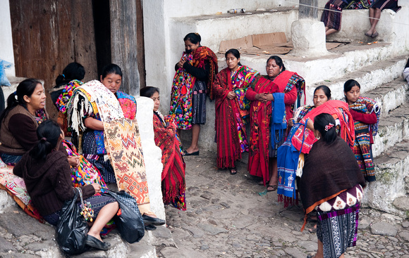 Local women wait to pounce on tourists as the enter the market! Chichicastenango, Guatemala, 2010
